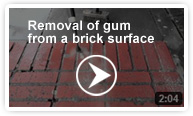 Removal of gum from a brick surface